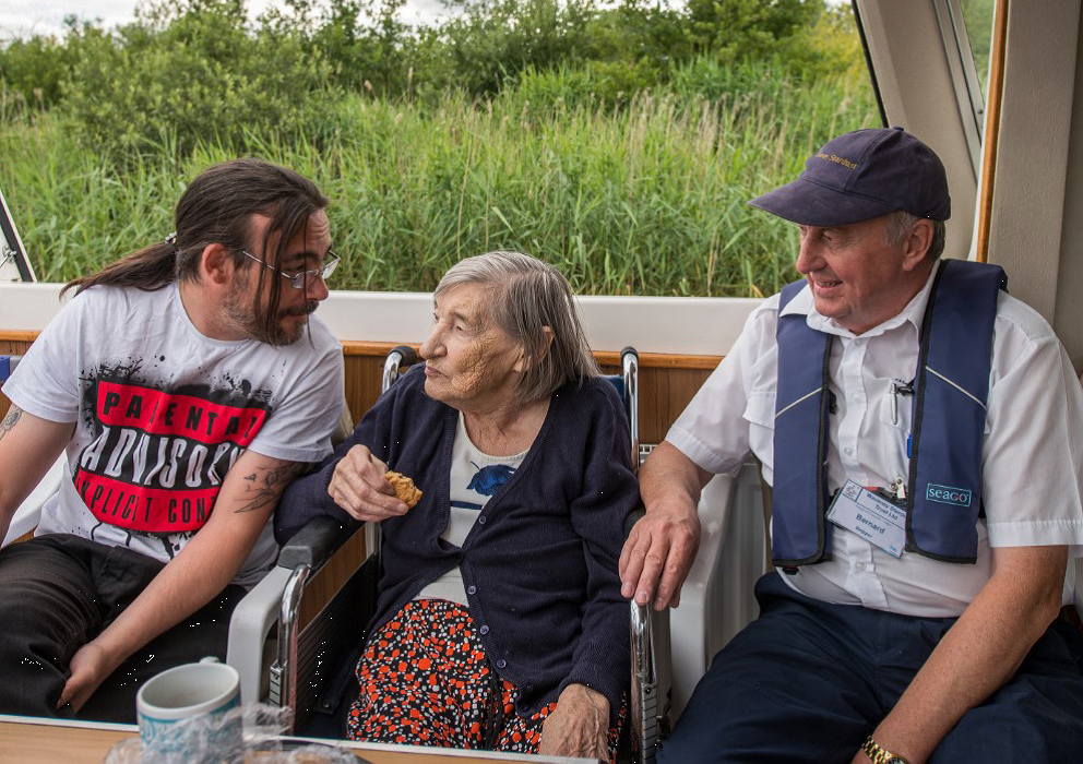 A photo of a woman in a wheelchair on the solar trip boat, Ra, which is based at Whitlingham Country Park