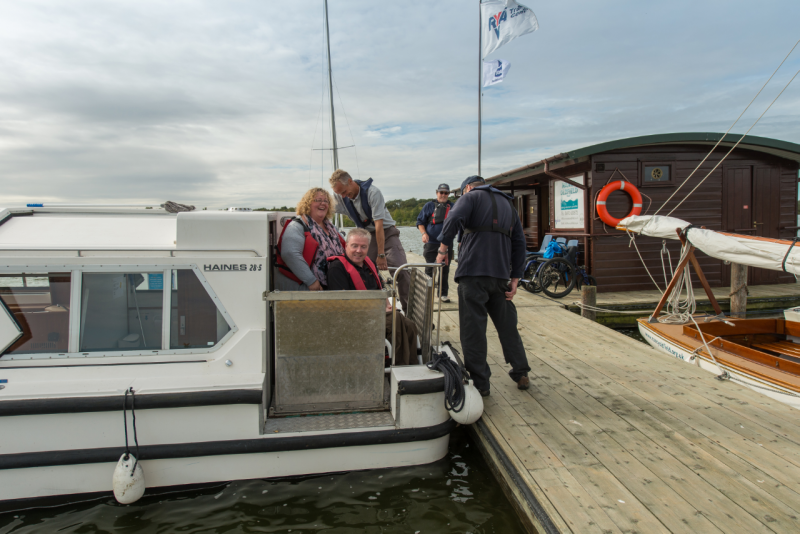 Man in wheelchair on board a trip boat on the Norfolk Broads