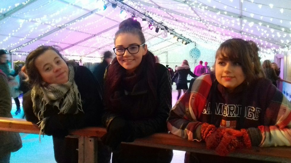 3 young adult carers enjoying an ice skating session.
